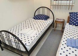 Schlafzimmer 3 mit einem Einzelbett und Schlafsofa.